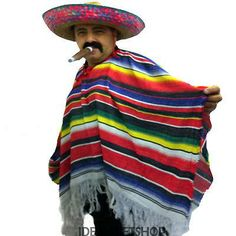 Mexican wearing a poncho and a hat, he also has a mustache and a sigar.