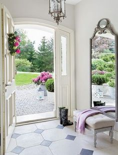 Inspiration image. Again, can be tweaked to be more shabby. I enjoy the ivory white on the door (could be distressed) and I thought the floor tile/pattern was very charming and can suit a shabby style.
