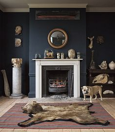 love the wall color, the white accents, and the bear rug. Bear Skin Rug, Bear Rug, Decoration Chic, Navy Walls, Black Walls, Fireplace Accessories, Dark Interiors, Fireplace Mantels, Mantle