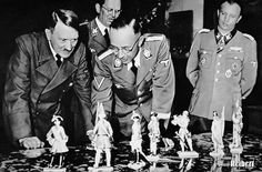 In this undated photo, Heinrich Himmler shows Adolf Hitler porcelain figurines of Frederic the Great-era soldiers. Hitler was a great admirer of Frederic and what he saw as the King's military genius. Watching on the right is Waffen SS-Gruppenführer Hermann Fegelein, brother-in-law to Hitler's mistress Eva Braun through his marriage to her sister, Gretl. Fegelein was shot for desertion on 28 April 1945, two days before Hitler's suicide.