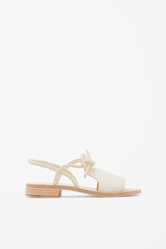 Designed to slip-on, these sandals are made from panels leather with knot detail on top and leather covered stacked heels.