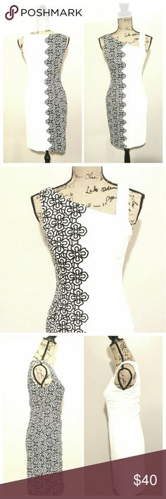 Nine west sheath dress size 4 Nine west black and white dress, floral print on one side, solid white on other side, size 4 shift dress, great condition. All my items are clean and are kept in a smoke free, pet free environment. Nine West Dresses Asymmetrical