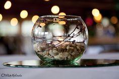 Glass bowl, stones, and stems wedding centerpiece #centerpiece #weddingcenterpiece #bokeh #atlantaweddingphotography #photography #weddingphotography #atlantaweddingphotographers #roswellmill #roswellwedding - Chris and Melinda Photography