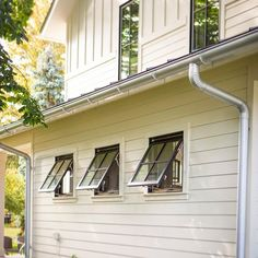 """Usually surprises during the building process aren't a good thing. We thought we had considered every detail, but we were surprised (pleasantly) when we cranked open our 30""""x30"""" windows and learned they were awning windows! We love how they look when opened, hinged at the top, reminiscent of barn or shed windows. There are 17 of these windows around the house. We love that we can keep them open in a light rain, unlike the rest of our large casement windows, and not worry about water getting i... Barn Windows, Shed Windows, Farmhouse Windows, Casement Windows, Church Windows, Crank Out Windows, Garage Transformation, Window Awnings, Shed Homes"""