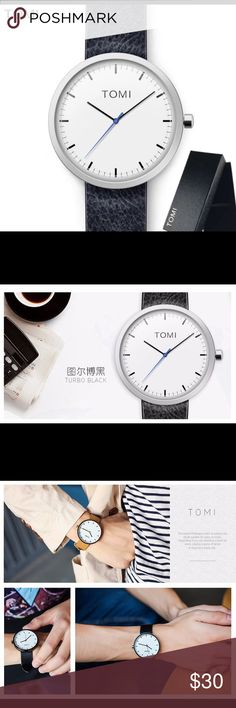 SALE! 🆕 Unisex Tomi Black Leather Watch w/ Gift! This watch from Tomi in Turbo Black features a black leather strap, white 44mm dial w/ Bright Blue seconds hand, Quartz Movement, and it's waterproof! The simple design of the watch makes it perfect for everyday wear. This purchase also includes a small gift! Limited Quantities! Tomi Accessories Watches