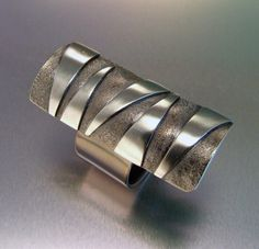 Fuze Ring by Melody Armstrong. More cool jewlry at the link.