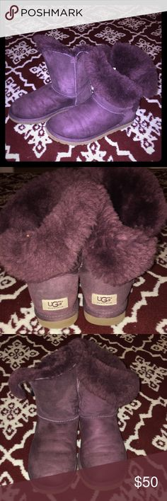 Bailey Button Uggs Great condition bailey Button uggs in a dark purple/eggplant color. I purchased these gently used for $65 just a year ago, & I wore them once. My feet grew an entire shoe size with my last pregnancy and these are too small. I was very sad because I love them!! They are so cute and I LOVE the color. There is no smell what so ever inside. The previous owner didn't wear them barefoot and I didn't either the one time I wore them. I just cleaned the outsides with ugg cleaner…