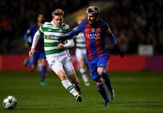 Stuart Armstrong of Celtic (L) and Lionel Messi of Barcelona (R) battle for possession during the UEFA Champions League Group C match between Celtic FC and FC Barcelona at Celtic Park Stadium on November 23, 2016 in Glasgow, Scotland.