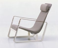 Cite by Jean Pouvre, 1930, produced by Vitra. Lounge chair with modern profile, leather arms, white and grey materials - speaks to today!