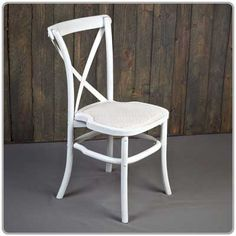 """White Distressed Bistro Chair -- with a white wicker seat pad. Chair is 34.5"""" high x 20"""" across the back. Seat height is 18""""."""