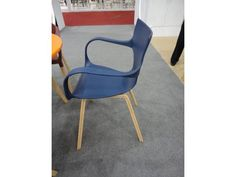 Plastic task chair with wooden legs