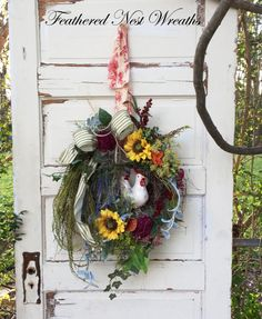 This Wreath is Made on a 14 Grapevine Base. I have added a Ceramic Rooster Nestled in Some Moss Color Coated Chicken Wire, along with Dried Burgundy Peonies, Sunflowers, Red Pepper Berries, Dried Quince, Lambs Ear, Yellow Dill, Artificial Lavender and Other Herbal Type Greenery. I Finished out the Wreath with a Moss Green Wire Ticking Ribbon. The Wreath hangs by a Gorgeous Piece of Yellow French Country Toile. This would just be so Pretty in a French Country Kitchen or would work Equally as…