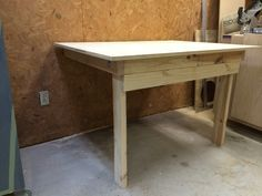 Folding Work Bench / Folds up to the wall when you're done