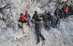 12 Most Shocking Photos of People Risking Their Lives