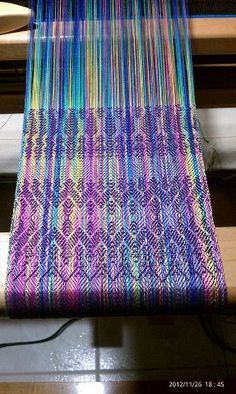 handwoven by Hanna Roehrs. Hand painted silk yarn.