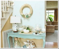 Annie Sloan chalk paint (color: Duck Egg) tutorial.  Foyer table is painted, lightly glazed and then waxed.  Wall above table is SW Sea Salt.  The colors and pattern of the pillow complement the table beautifully.