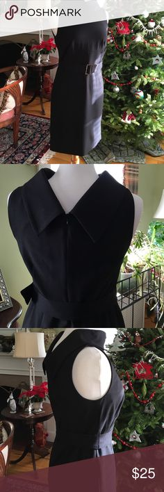Black dress by Adrienne Vittadini Everyone should have a black dress that can go to work or out to play. I have too many😳 This dress is beautifully styled with a back V collar, zip back and self belt. Polyester, rayon and wool. Worn once. Adrienne Vittadini Dresses Midi