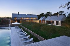An East Hampton, NY residence located within a private seaside community with its modern design that was streamlined to work with the homes surrounding it.