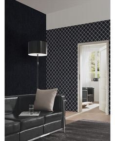 This Opal Geometric Glitter Wallpaper in black and silver features a contemporary geometric pattern infused with subtle glitter. Free UK delivery available