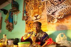 Taita Marcelino preparing medicine for his patient in the morning after ayahuasca ceremony held in his house in Sibundoy, Putumayo in Colombia. Part of online guide to ayahuasca shamanism of Amazon region.