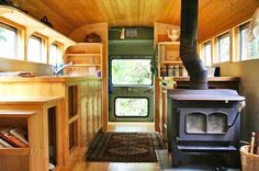 Old School Bus Converted into a Sweet Earthy Home With a Wood-fired Stove.