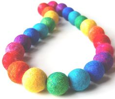 Rainbow Revolving - A colourful necklace made from a revolving spectrum of hand felted beads. by therainbowroom, via Flickr