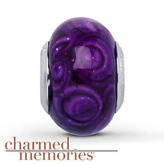 Charmed Memories Purple Murano Glass Charm Sterling Silver Stock number: 811376805 From the Charmed Memories® collection, this charm is crafted in sterling silver and features purple swirl Murano glass.