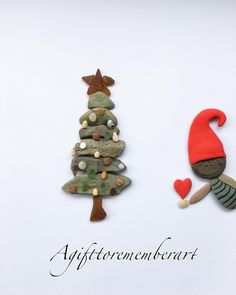 """Merry Christmas"" hope you all have a lovely Xmas, with a love heart from a cute Elf to you all ❤️ #agifttorememberart #pebbleart #art #handmade #nature #elf #christmastree #clayart #etsy #makersgonnamake #instagood #instaphoto #instaart #photooftheday #australia #adelaide #beach #gift #giftideas #christmasgift #roomdecor #interiordesign"