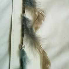 **SALE**Feather Hair Clip New Greg with Tan Feathers with beads hair clip attached to synthetic hair. The comb/clip is 1 inch wide and the extension from clip to end of feathers is 22inches. I have 2 in this color and they are still in the plastic. Message me if you only want one. Other colors available Accessories