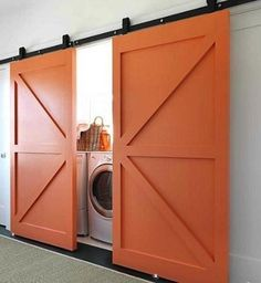 Hidden Washer/Dryer Behind Sliding Barn Doors, Remodelista