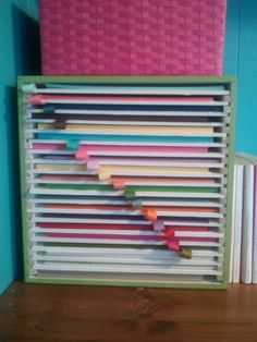 """We took an unfinished cube from Michaels and used 3/8"" square wooden spacers and foam poster board. I used a 3"" piece of grosgrain ribbon to show which color is in that space. Now I can see each color (and how much I have so I can keep a better inventory.)"""