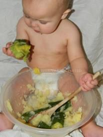 BABY PLAY ACTIVITY I boiled some potato & courgettes until they were soft, I mashed the potato but left the courgettes whole. I placed baby Noah (8 months) on an old sheet, I gave him the bowl with a wooden spoon and let him explore, Mila (4) also loved getting her hands stuck in :-)