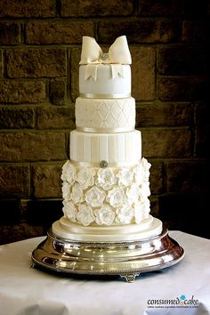 Impressive Ivory & White Bow & Ruffle Flower Wedding Cake by Consumed by Cake