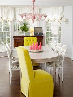 """Mismatched Chairs  Seating is """"a major opportunity for fun,"""" says Bailey. Her host chairs are citron velvet; the side chairs are covered in a hummingbird/botanical print."""