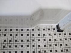 DIY: Cleaning Re-Caulking Bathroom Tile - tutorial explains products tips used to give an outdated bathroom a facelift.