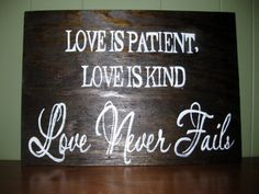 Love Never Fails on Wood Sign 17 by 24 by BurlaptoPearls on Etsy, $50.00