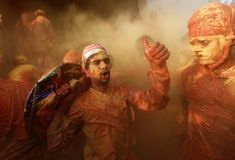 Lathmar Holi festival: colour and beating with sticks – in pictures