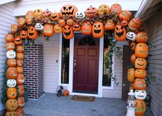 Don Morin: 2011 HALLOWEEN PUMPKIN ARCH CONSTRUCTION tutorial.  Two parallel PVC arches set over rebar footings reinforced with narrow plank at top and crossbars at regular intervals between upright sides.  Foam pumpkins wired on PVC with leaf infill.  Illuminated.  Boss!!