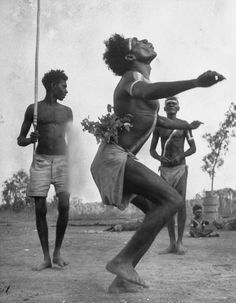 INDIGENOUS PEOPLE - Australian aborigines dancing with a child watching in the background, Australia, 1951, photo: Fritz Goro