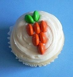 Easter Carrot Cupcakes ~ the carrot design is made with six orange M & M's and 2 green M & M's...love it!!