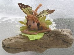 polymer clay miniature angel fairy art doll hand sculpted fantasy figurine. $45.00, via Etsy.