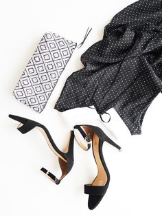 Black and white women's fashion street outfit // black high heels, aztec pattern clutch, cute polka dots dress with ribbon