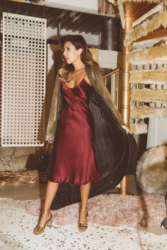 Sexy holiday outfit: silk slip dress, metallic duster, and gold heels