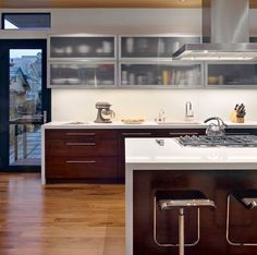 Wooden lower cabinets and frosted glass upper cabinets bring in a perfect contrast Cabinet color Glass contrast