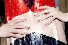 Negative space was clearly a big trend at this year's fall fashion week. We're in love with this autumnal-hued geo manicure by Alicia Torello, created with Christian Louboutin Nail Colour in...