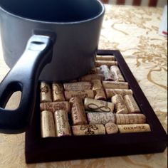 Great idea for recycling wine corks! Put in a picture frame to make a hotplate for pots and pans. Another idea for recycling wine corks is to put them in a mirror frame, and use it as a bulletin board!