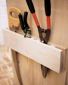 To prevent tools from getting jostled around and scratching one another, put them in a wall or door rack that holds each tool snugly. Make one by using two 1-by-6 pieces of wood; attach 2-inch wood blocks between the boards at different intervals to hold each tool firmly in place.