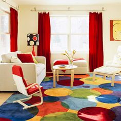 ❉ family room with kid-size chair and bold area rug