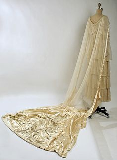 Beaded silk wedding dress (back, with train) by Lucile, British, 1915.