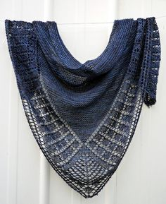 wonderful handknit shawl - so many ways to wear it as long as it is not how your granny wore it.